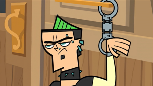 File:DuncanHandcuffed.png