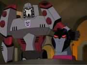 TFA Megatron smacks Starscream head