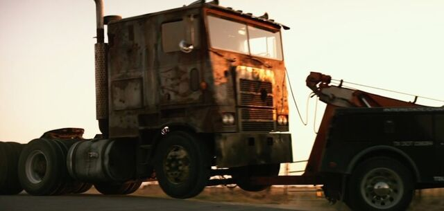 File:Cade Tows Optimus.jpg
