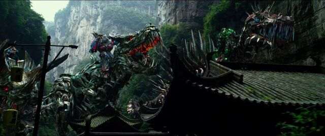 File:Drift Riding Slug Optimus Riding Grimlock Crosshairs Riding Scorn.jpg