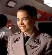 Denise-richards as Carmen