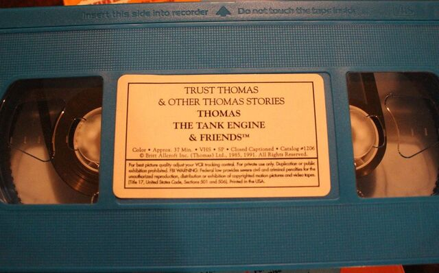 File:TrustThomas1995BlueTape.jpg