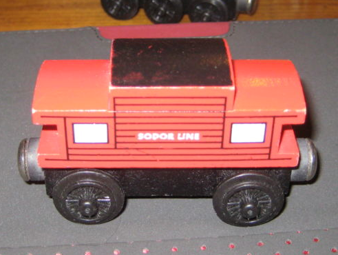 File:1992woodenrailwaysodorlinecaboose.png