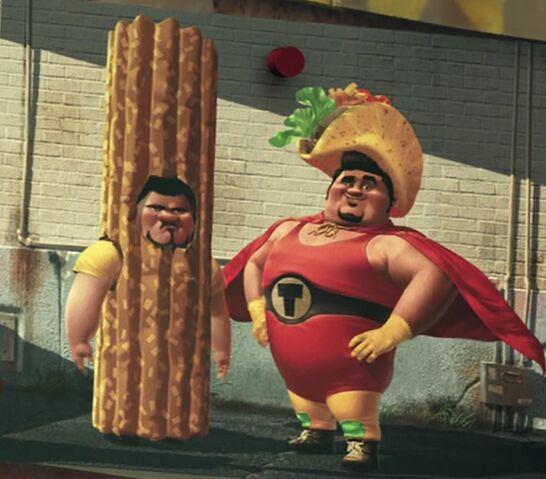 File:Tacoman and sidekick churro.jpg