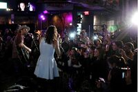 Nikki Reed and husband Paul McDonald perform for fans