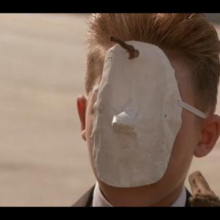 Grandson with eyeless mask
