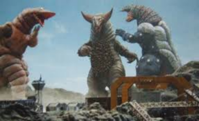 File:Gomora vs Golza & Telesdon.png