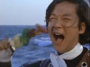 Seiji eats a shish kebab
