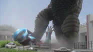 Ginga gets stepped on by gomora