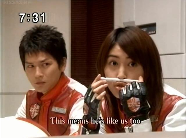 File:Mizuki places a pen on her lip.png