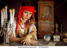 Stock-photo-gypsy-fortune-teller-wonders-on-the-magic-ball-gypsy-fortune-teller-read-the-cards-517869025