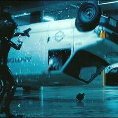 Selene knocks over an Antigen vehicle.