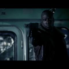 Raze fires at a fleeing Death Dealer.