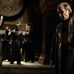 Viktor converses with Selene before leaving to attack the Lycan den.