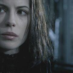 Selene glares at Kraven.