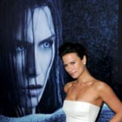 Rhona Mitra in front of a giant poster of herself as Sonja.