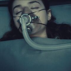 A sedated Eve being transported.