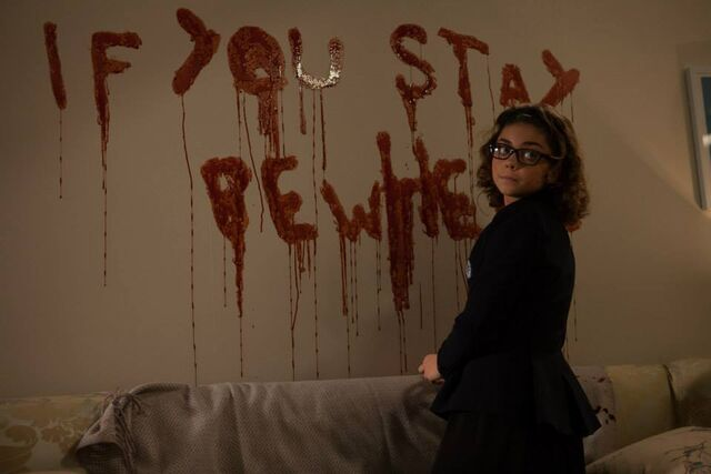 File:Nat next to bloody message.jpg