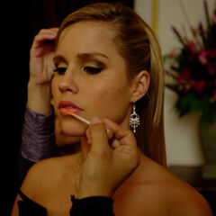 Claire Holt getting makeup on
