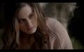 1x07-Klaus bites Elijah.png