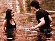 Damon pushing Elena into lake