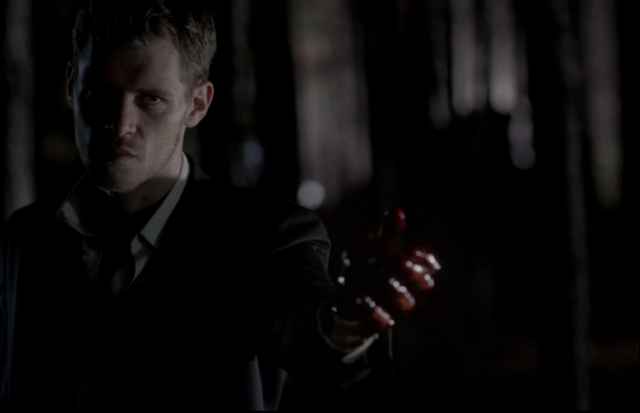 File:Klaus holding adrian's heart.png
