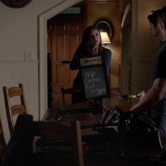 It's from the entrance behind Elena, it's still the same table