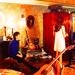 Damon sitting and Elena in front of the mirror