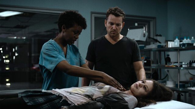 File:Coming Back 1x04 Axel and Doc examine Cynthia's body.jpg