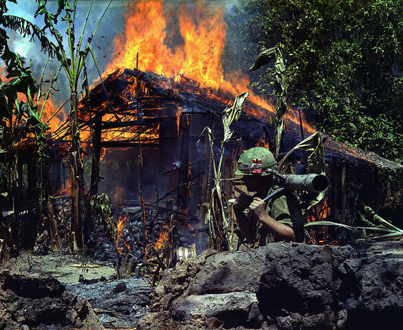 File:My Tho, Vietnam. A Viet Cong base camp being. In the foreground is Private First Class Raymond Rumpa, St Paul, Minnesota - NARA - 530621 edit.jpg