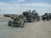 M1114 towing M102 Howitzer