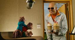 Ian offering the Chipmunks milkshakes