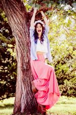 Tini hanging in a tree