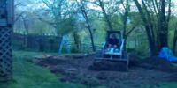 William watches his back yard being leveled for a swimming pool
