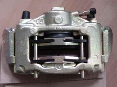 File:Installing-brake-pads.jpg