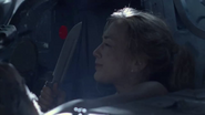 Beth Readying her knife in the car with Daryl