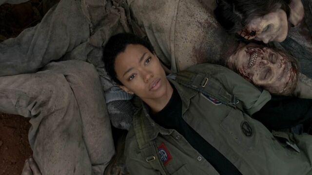 File:Sasha lying with zombies 1.jpg