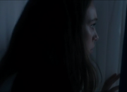 File:Looking out of the window, Alicia sees someone.png