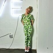Emily in a green cute suit with a shy pose so adorable