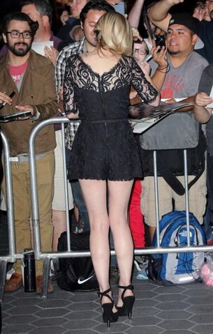 File:Emily's back while signing at the red carpet.JPG