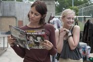 Lauren reading a TWD magazine while Emily is being adorable in the back