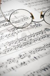 2651936-old-reading-glasses-resting-on-old-sheet-music