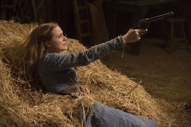 File:Dolores holding the gun.jpg