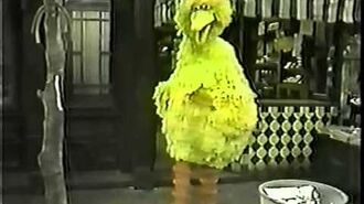 Big Bird cheerfully sings Somebody Come and Play.