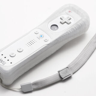 A Wii Remote with its protective jacket.