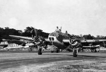 Twin-engined military aircraft on runway