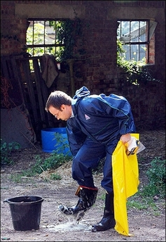 File:ManWashingBoots.jpg
