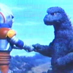 <b>Godzilla handshaking Jet Jaguar in <i>Godzilla vs. Megalon</i>, which also Shameless Fox did to ReginaGoji after they made the two Breach kaijus retreat.</b>