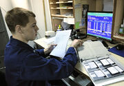 US Navy 110129-N-7676W-152 Culinary Specialist 3rd Class John Smith uses the existing DOS-based food service management system aboard the aircraft