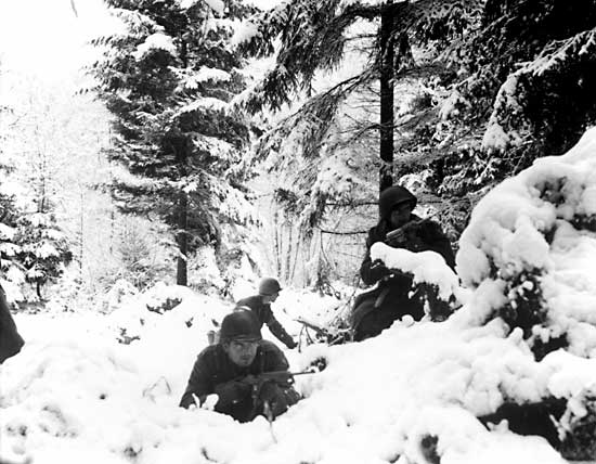 File:American infantry of 290th Regiment take cover in trees, Belgium 1945.jpg